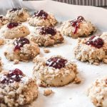 raspberry Thumbprints on a cookie sheet