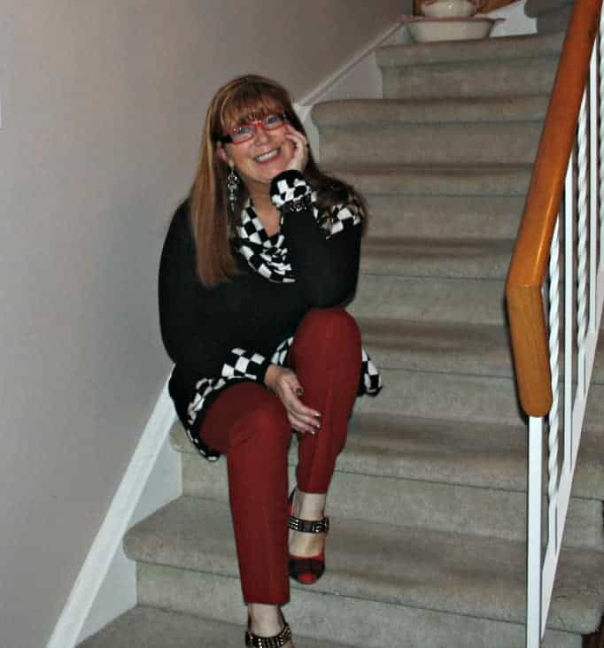 black and white checked tunic and red pants