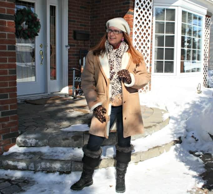 Leopard scarf, sheepskin coat and Jim Beam cap