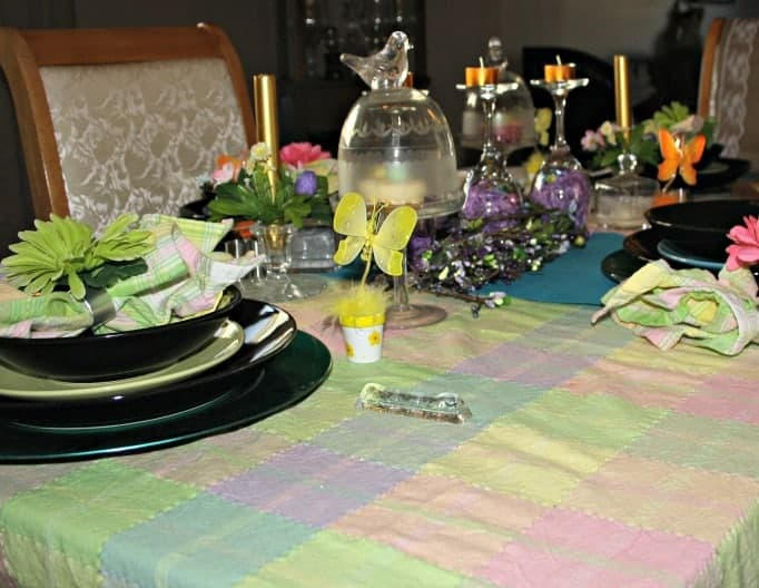 Easter Table Setting, pastel tablecloth, flowers, birds and butterfly's
