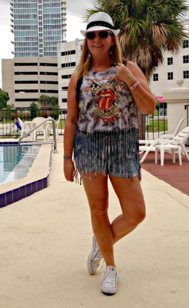 F21 Rolling stones t shirt and sunglasses and Old navy denim shorts. Fedora and converse