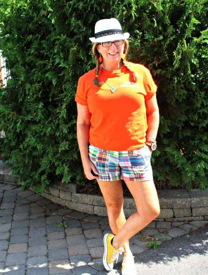 Orange NDP shirt and J Crew shorts with yellow converse