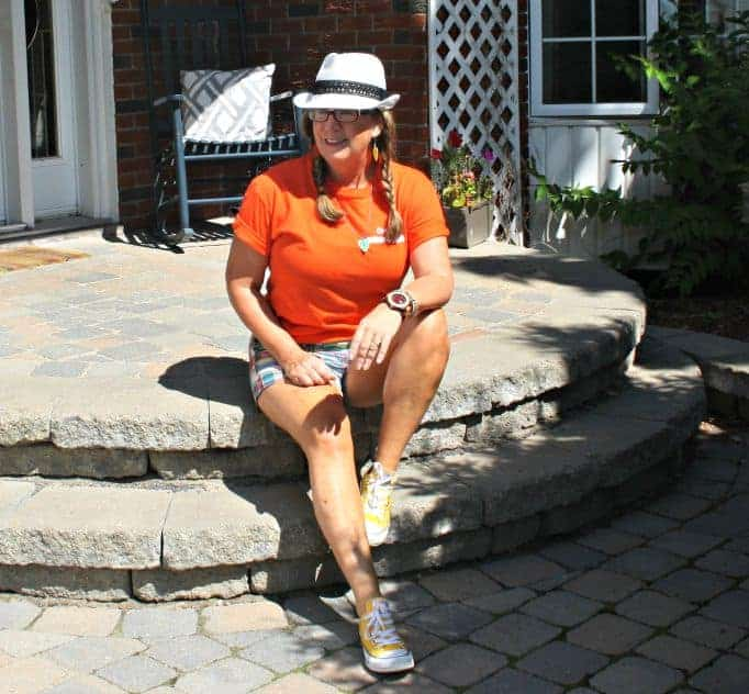 Orange shirt for NDP and J Crew shorts with fedora and converse