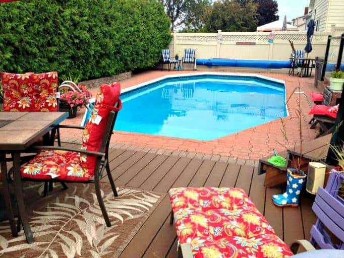 pool in the backyard with bright florals