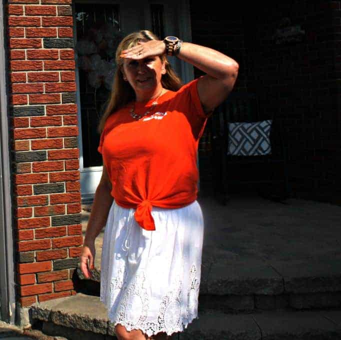 white skirt and orange NDP shirt