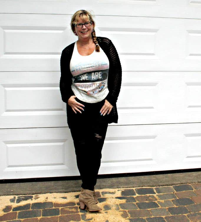 distressed jeans and tank withopenweave sweater and rodeo boots