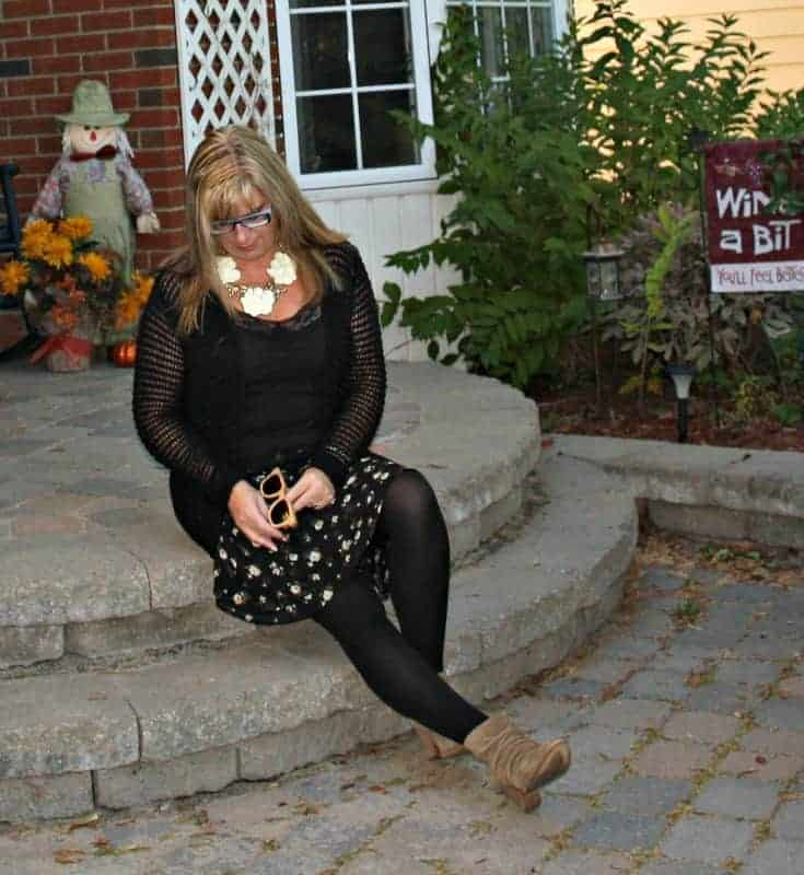 blacj sweater and floral chiffon skirt, Rodeo boots with konifer glasses and a happiness boutique necklace