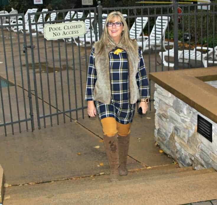 Old navy plaid tunic and pixie pants with a fur vest and a floral necklace