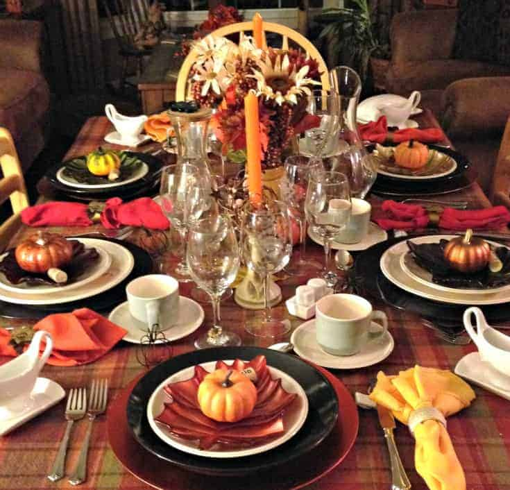 Thanksgiving tablescape with flowers and pumpkins