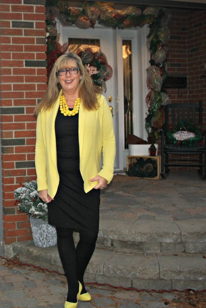 Always bright in Vanheusen Yellow Cardigan with a LBD and matching Signature pumps from Shoe Dazzle