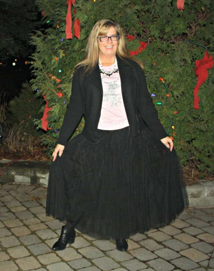 Glitter Reindeer shirt with a black tulle skirt and a moto jacket 12