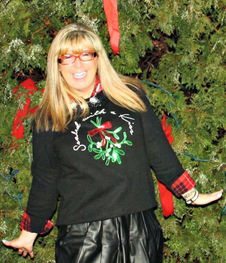 H&M Christmas sweater with flannel and a leather skirt,