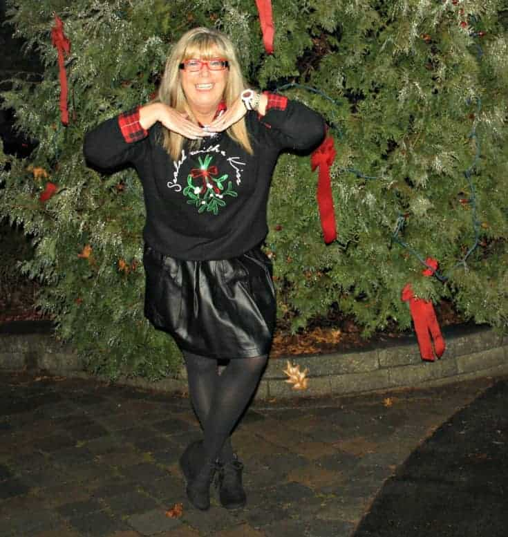 H&M Christmas sweater with flannel and a leather skirt, kate spade watch