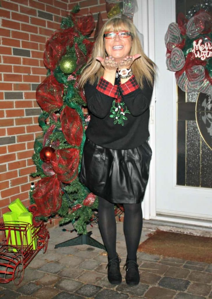 H&M Christmas sweater with flannel and a leather skirt, wedge boots by George 8