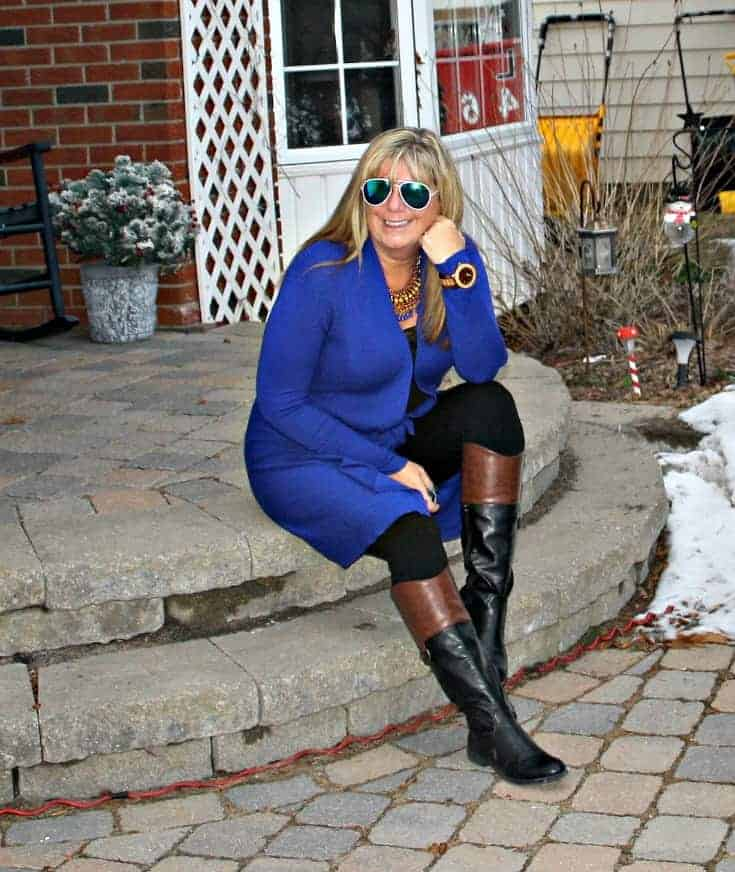 sitting reflecting in Royal Blue Cardi and tights from Giant Tiger and Target boots