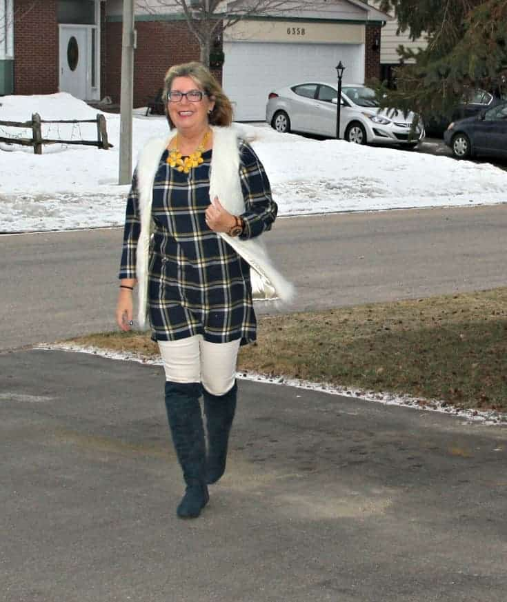 old navy blue plaid dress and white fur vest and blue suede boots with white denim
