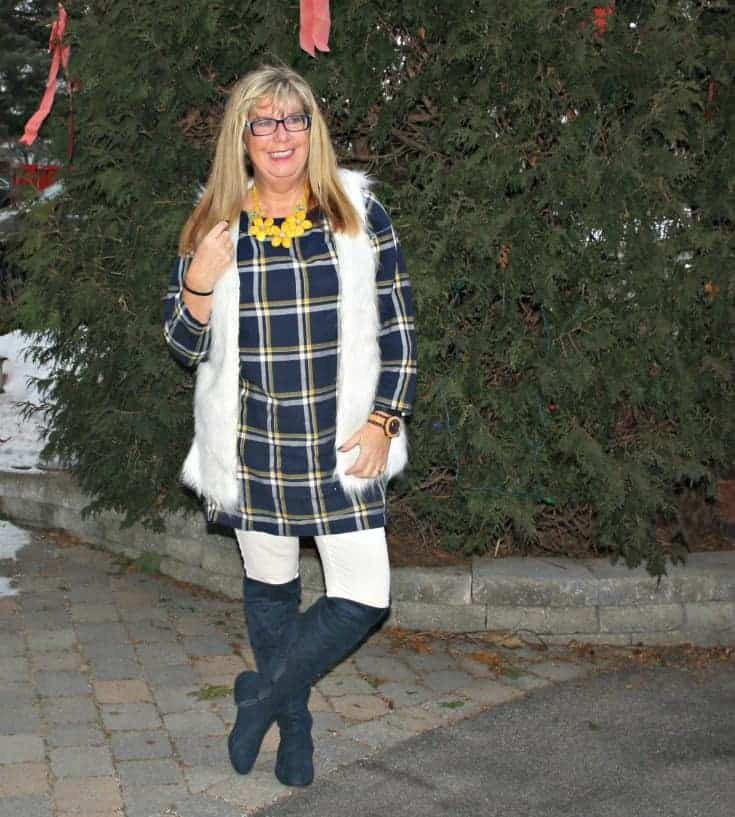 old navy plaid dress and white fur vest and blue suede boots and yellow floral necklace