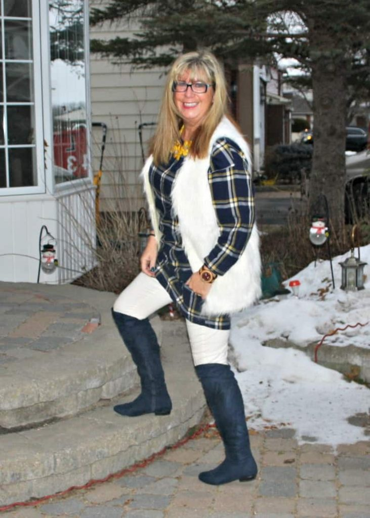 old navy plaid dress and white fur vest and blue suede boots with a jord watch