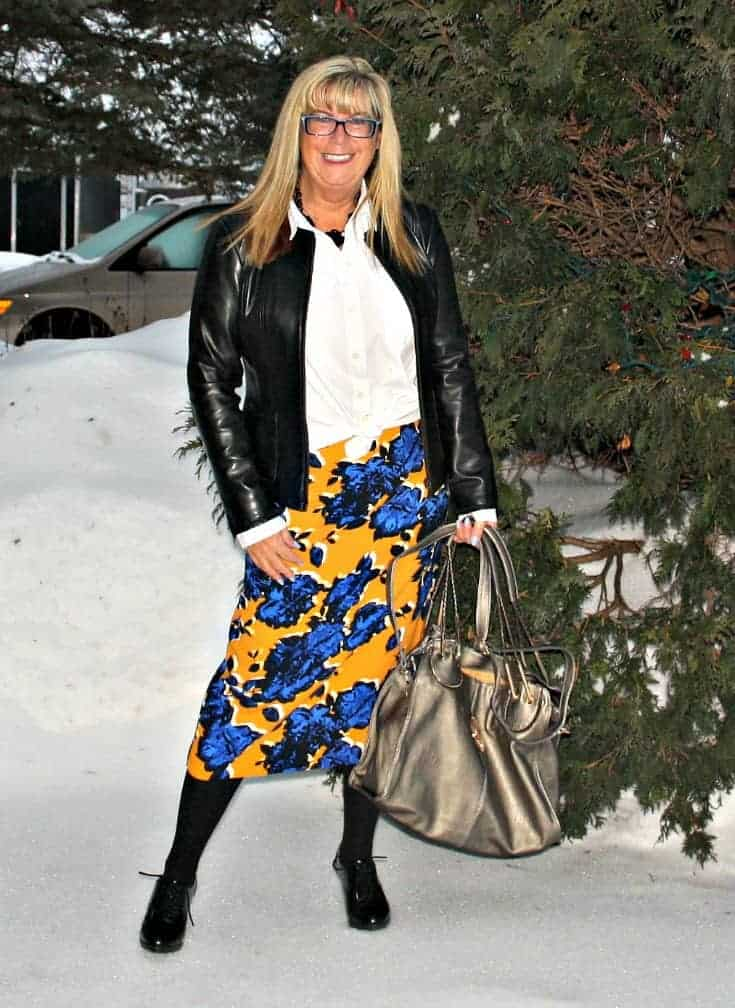Target Floral skirt with leather blazer and heeled brogues with a metallic Bag from MK