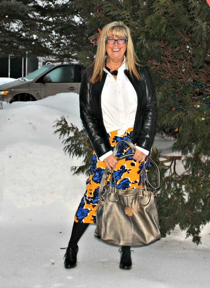 Target Floral skirt with leather blazer and heeled brogues with metallic tote