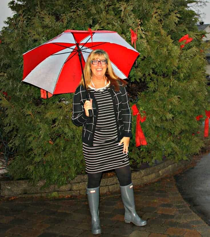 Striped dress with a windowpane cardigan and hunter boots