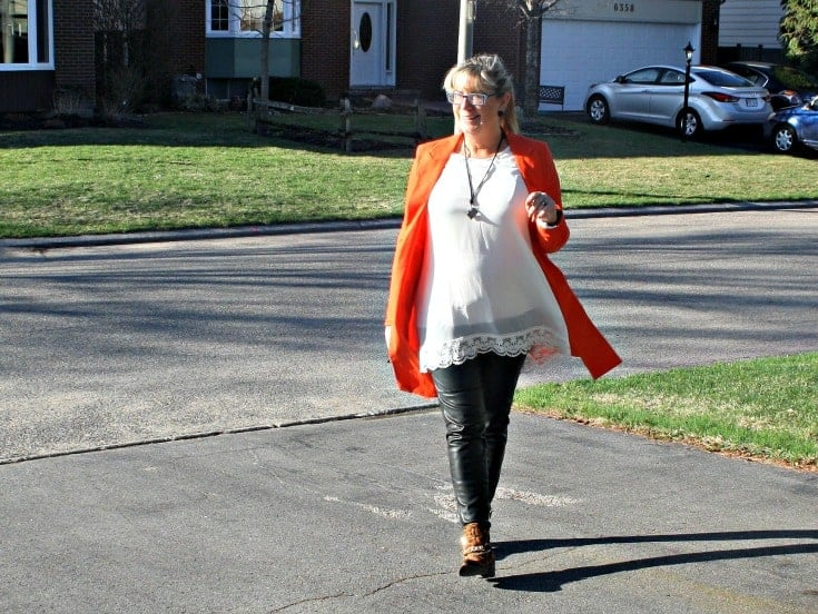 rocking the Orange Jacket from Shein with a leopard bootie