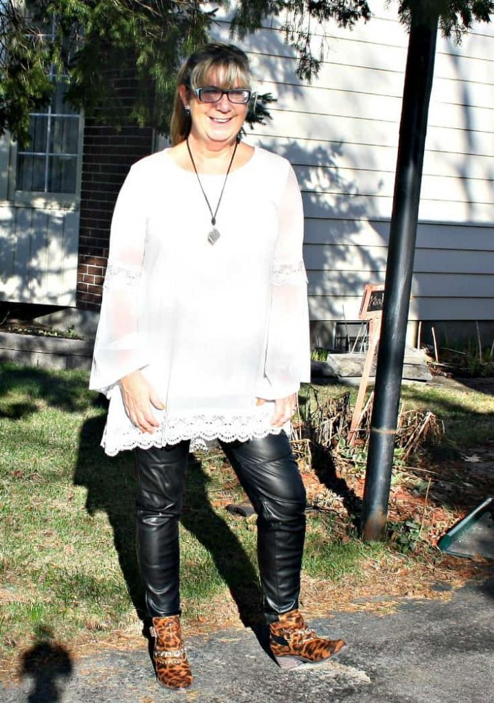 Cream tunic and leather leggings with a leopard boot, topped with a camera necklace from New Look