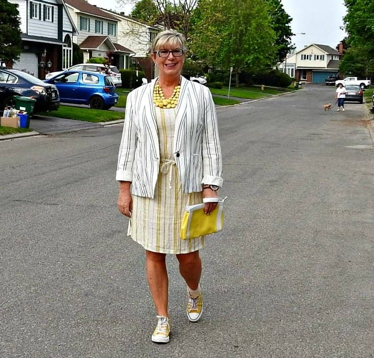 Old navy linen blazer and a yellow stripped dress with converse and a kate spade clutch