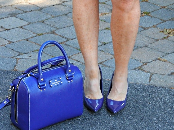 purple pumps and a kate spade bag all paired with Jord