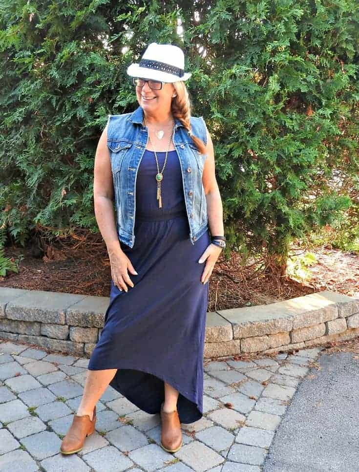 hi lo dress with denim vest, a fedora and booties