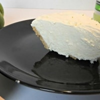 Margarita pie on a black dinner plate