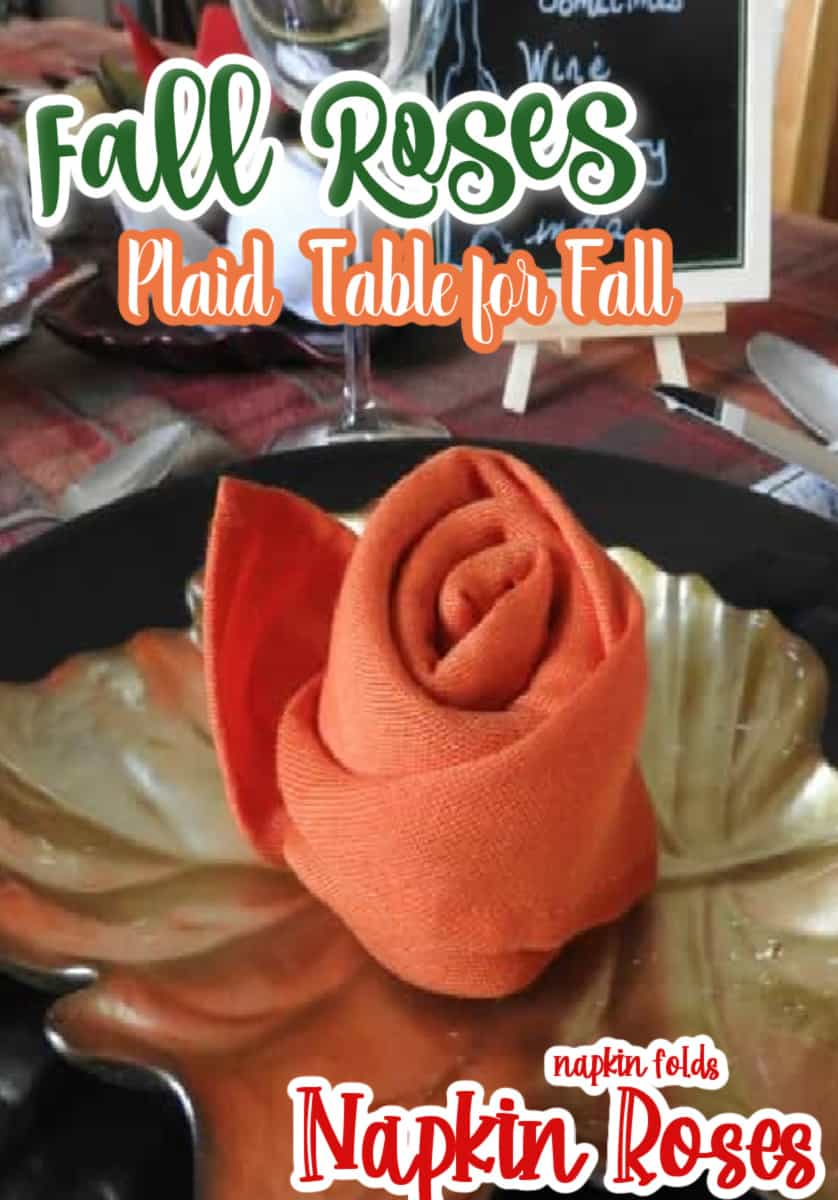 a rose napkin fold on a gold leaf plate