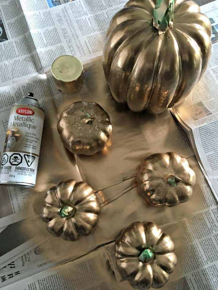 Fall pumpkins in white, gold and orange create a perfect mantle