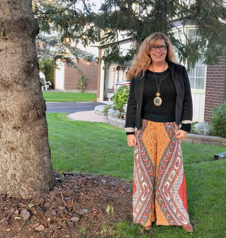 flowy pants from Forever 21, fun booties ( also F21) and a mesh sweater and blazer ( Banana Republic and Ricki's)  Added my necklace from Sylca Designs for an added punch