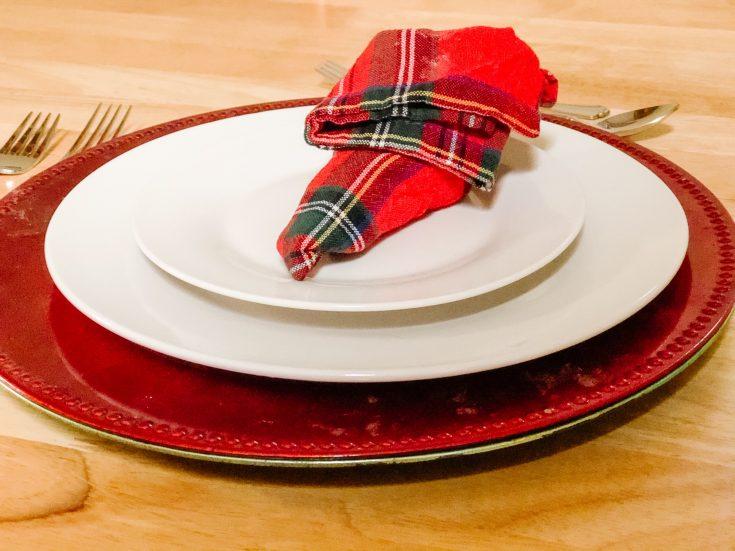 elf shoe napkin on a white plate