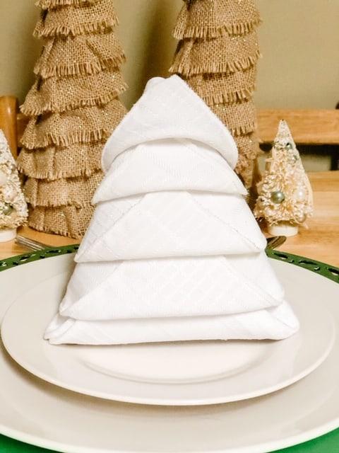 standing Christmas tree napkin on a plate