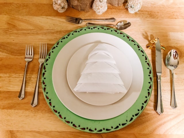 white Christmas tree napkin on a plate