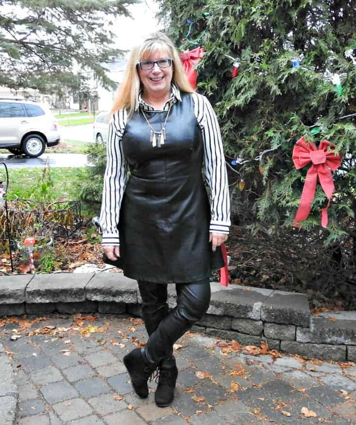 Forever 21 leather dress with leggings and a wedge boot plus my 7 charming sisters tassel necklace