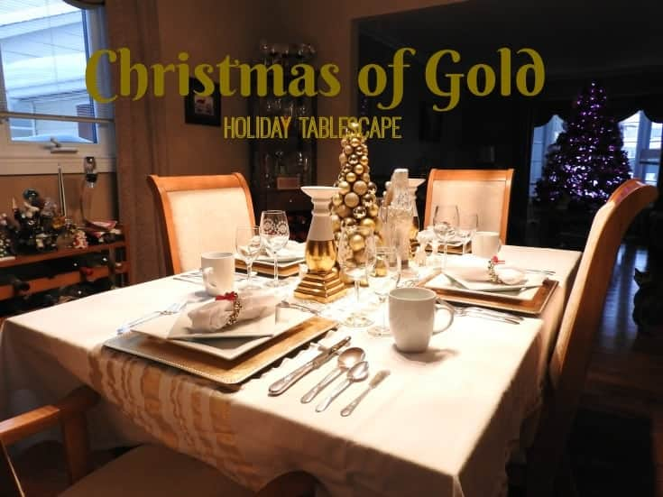 white and gold table settings with reindeer and trees