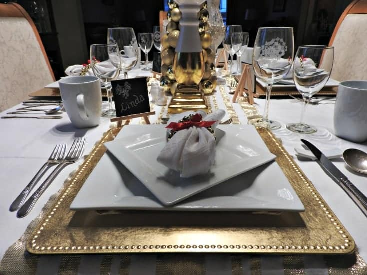 white and gold table settings with square gold chargers