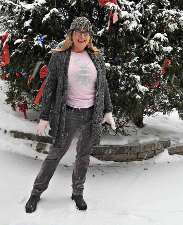 grey velvet jeans, A glitter reindeer shirt and a winter cardigan.