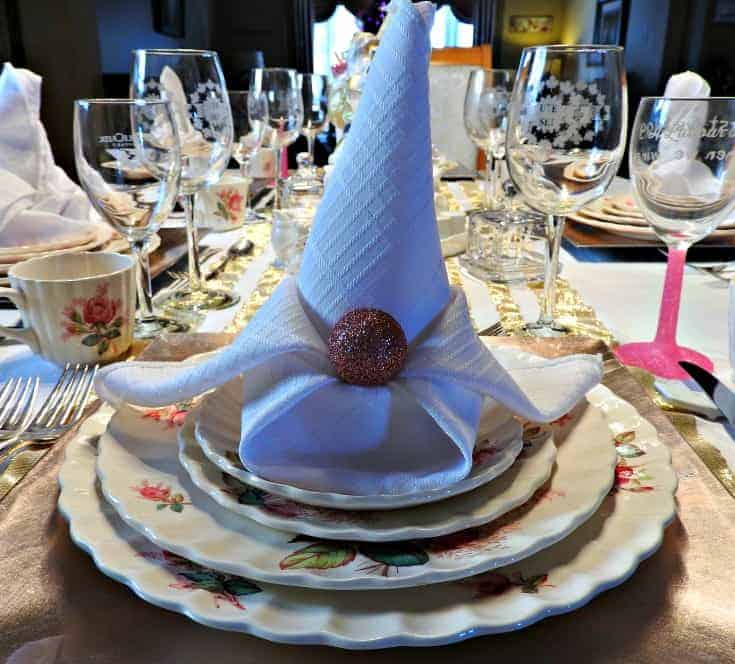 napkin folds and pink christmas balls