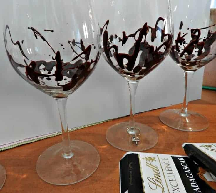 Bourbon Chocolate Mousse with chili chocolate served in chocolate drizzled wine glasses
