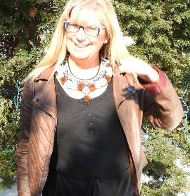 a moto jacket and a pom pom necklace from 7 Charming sisters