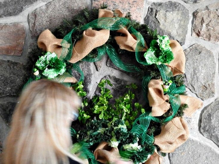 adding leprechans and carnations to a st paddys day wreath