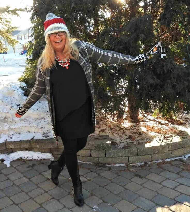 Laura Sweater and a LNB Footprints tunic and a 7 charming sisters necklace