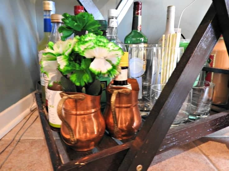 decorating my bar cart for St Patrick;'s Day with carnations