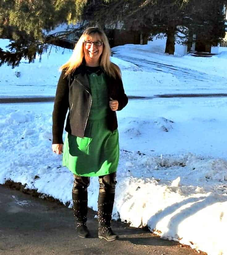 strolling in an Old Navy green dress for st patricks day with a moto jacket