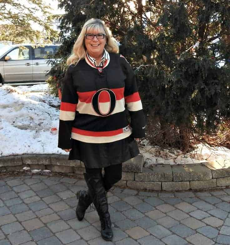 leather dress and striped blouse from Forever 21 with an Ottawa Senators Hockey Jersey and Shoe Dazzle boots for my hockey pose