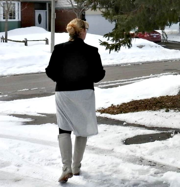 walking in the snow in Heather grey tunic with a moto and shoe dazzle boots